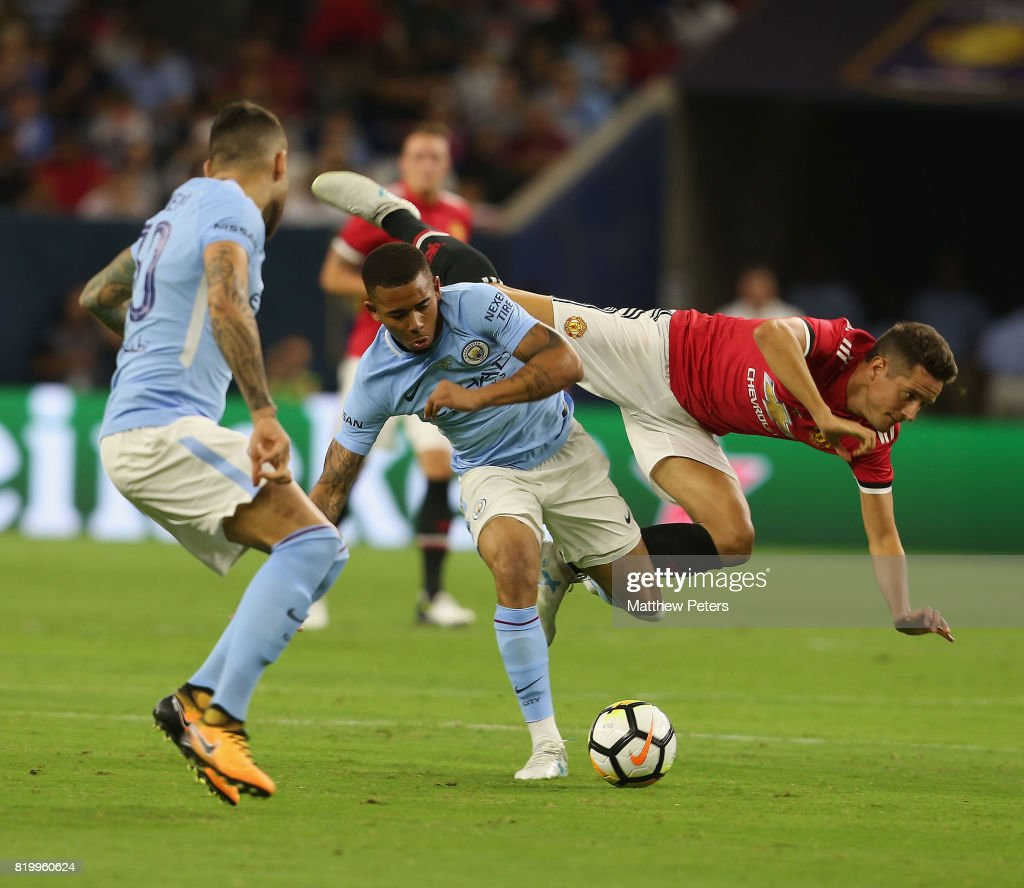 Ander Herrera of Manchester United in action with Gabriel Jesus of Manchester City during the pre-season friendly International Champions Cup 2017 match between Manchester United and Manchester City at NRG Stadium on July 20, 2017 in Houston, Texas.