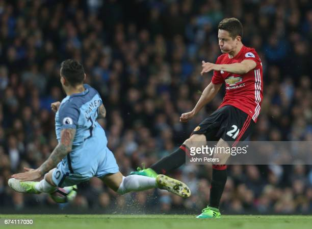 Ander Herrera of Manchester United in action with Nicolas Otamendi of Manchester City during the Premier League match between Manchester City and...