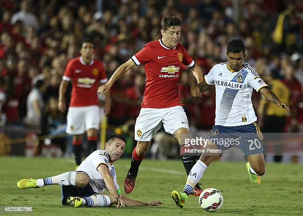 Ander Herrera of Manchester United in action with Robbie Keane and AJ Delagarza of Los Angeles Galaxy during the preseason friendly match between LA...