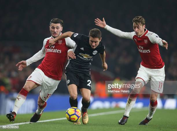 Ander Herrera of Manchester United in action with Sead Kolasinac and Mesut Ozil of Arsenal during the Premier League match between Arsenal and...
