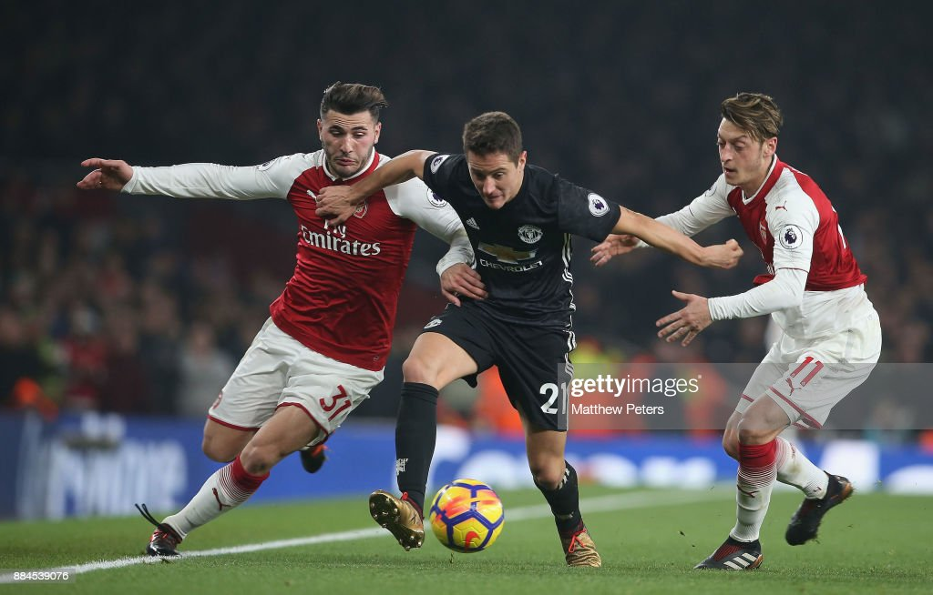 Ander Herrera of Manchester United in action with Sead Kolasinac and Mesut Ozil of Arsenal during the Premier League match between Arsenal and Manchester United at Emirates Stadium on December 2, 2017 in London, England.