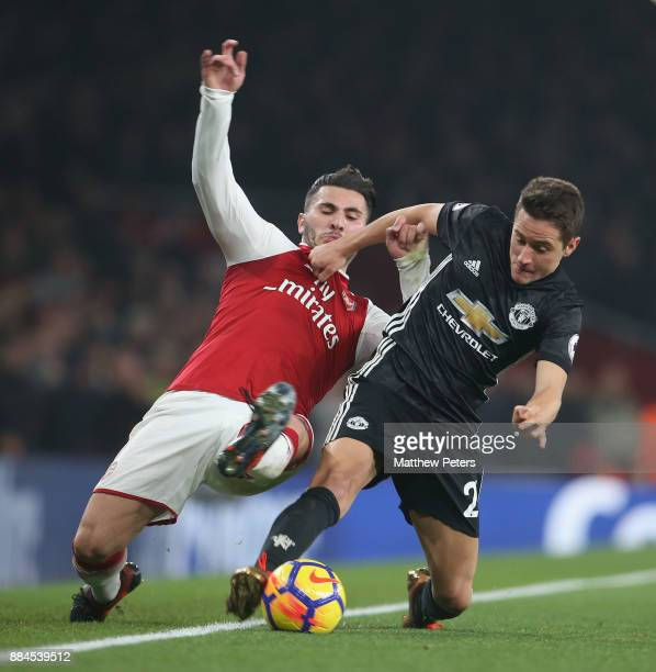 Ander Herrera of Manchester United in action with Sead Kolasinac of Arsenal during the Premier League match between Arsenal and Manchester United at...