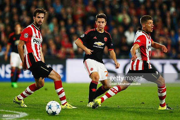 Ander Herrera of Manchester United is closed down by Davy Propper and Stijn Schaars of PSV Eindhoven during the UEFA Champions League Group B match...
