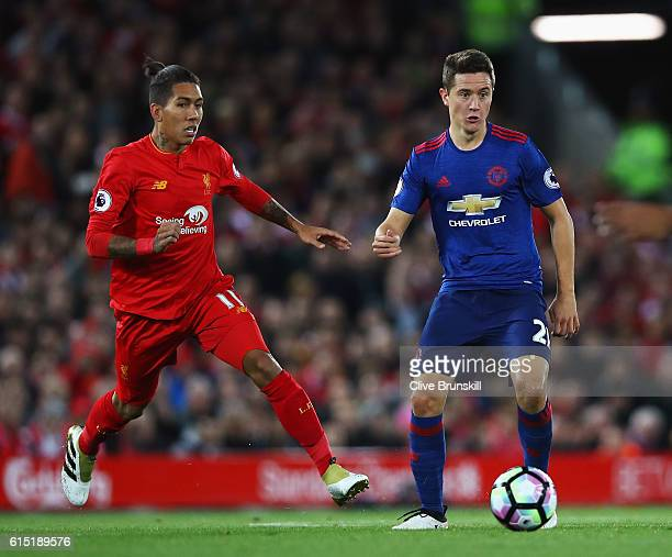 Ander Herrera of Manchester United is closed down by Roberto Firmino of Liverpool during the Premier League match between Liverpool and Manchester...