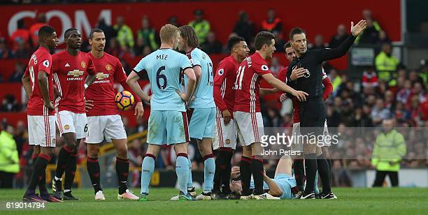 Ander Herrera of Manchester United is sent off by referee Mark Clattenburg during the Premier League match between Manchester United and Burnley at...