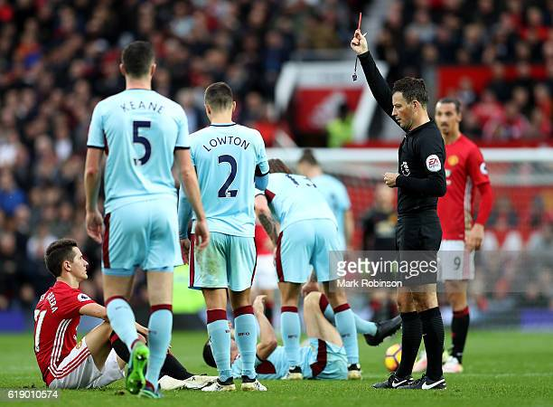 Ander Herrera of Manchester United is shown the red card by referee Mark Clattenburg after the second yellow card during the Premier League match...