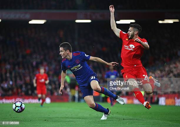 Ander Herrera of Manchester United moves away from Adam Lallana of Liverpool during the Premier League match between Liverpool and Manchester United...