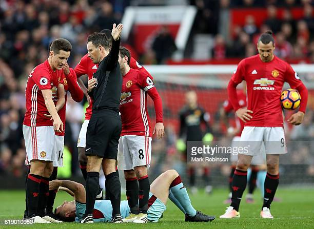 Ander Herrera of Manchester United protests to referee Mark Clattenburg after the red card during the Premier League match between Manchester United...