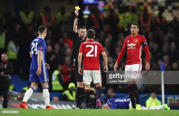 Ander Herrera of Manchester United reacts as he is shown a yellow card by referee Michael Oliver during The Emirates FA Cup QuarterFinal match...