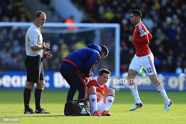 Ander Herrera of Manchester United receives a medical treatment during the Barclays Premier League match between Watford and Manchester United at...