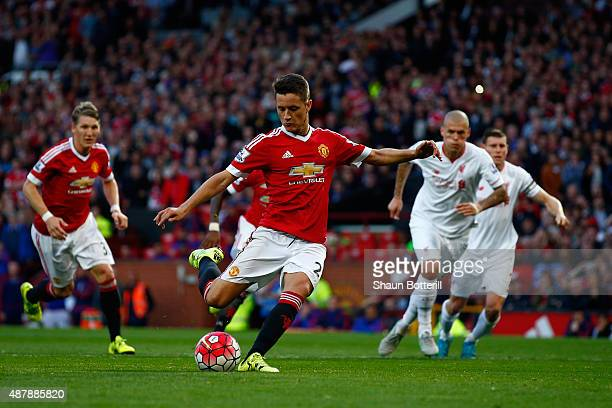 Ander Herrera of Manchester United scores from the penalty spot during the Barclays Premier League match between Manchester United and Liverpool at...