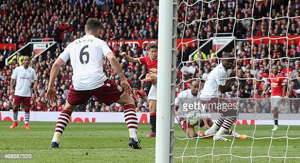 Ander Herrera of Manchester United scores their first goal during the Barclays Premier League match between Manchester United and Aston Villa at Old...