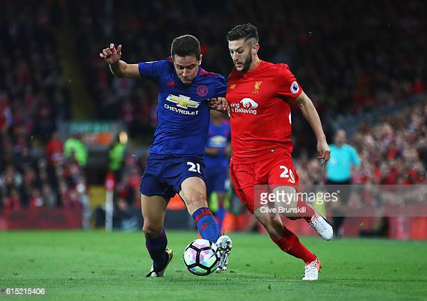 Ander Herrera of Manchester United takes on Adam Lallana of Liverpool during the Premier League match between Liverpool and Manchester United at...
