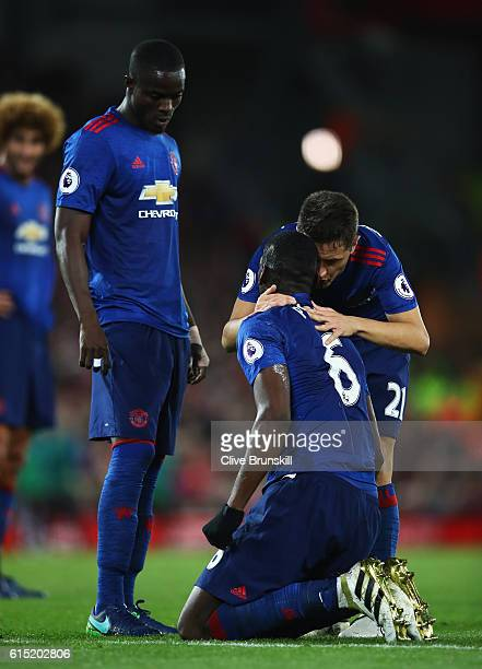 Ander Herrera of Manchester United talks to Paul Pogba of Manchester United during the Premier League match between Liverpool and Manchester United...