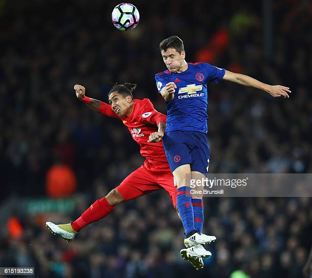 Ander Herrera of Manchester United wins a header with Roberto Firmino of Liverpool during the Premier League match between Liverpool and Manchester...
