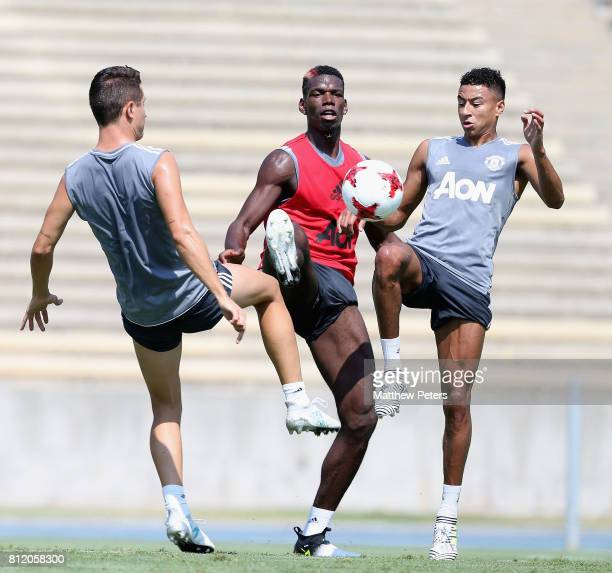 Ander Herrera Paul Pogba and Jesse Lingard of Manchester United in action during a first team training session as part of their preseason tour of the...
