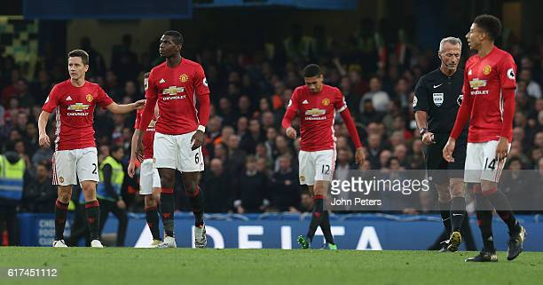 Ander Herrera Paul Pogba Chris Smalling and Jesse Lingard of Manchester United react to conceding a goal during the Premier League match between...