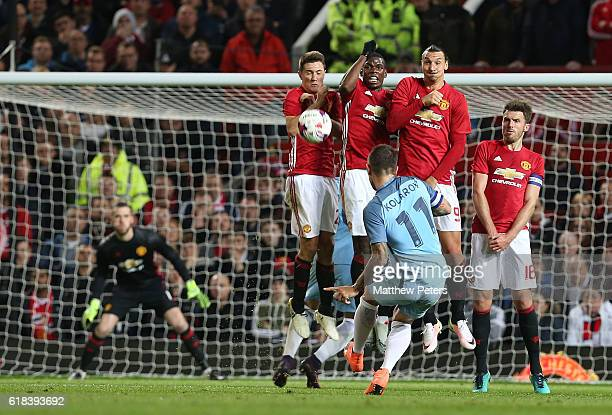 Ander Herrera Paul Pogba Zlatan Ibrahimovic and Michael Carrick of Manchester United defend a free kick from Aleksandr Kolarov of Manchester City...