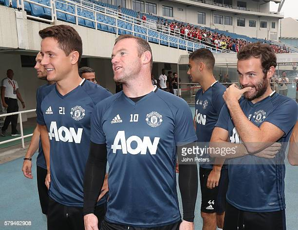 Ander Herrera Wayne Rooney and Juan Mata watch as manager Jose Mourinho of Manchester United speaks during a press conference as part of their...