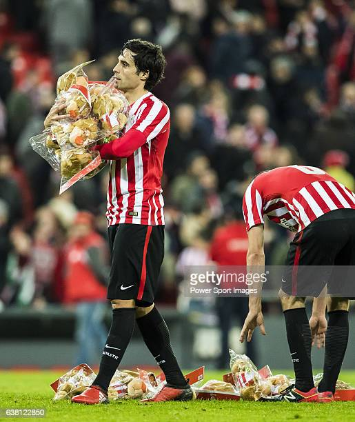 Ander Iturraspe Derteano of Athletic Club carries stuffed toys for the fans after their Copa del Rey Round of 16 first leg match between Athletic...