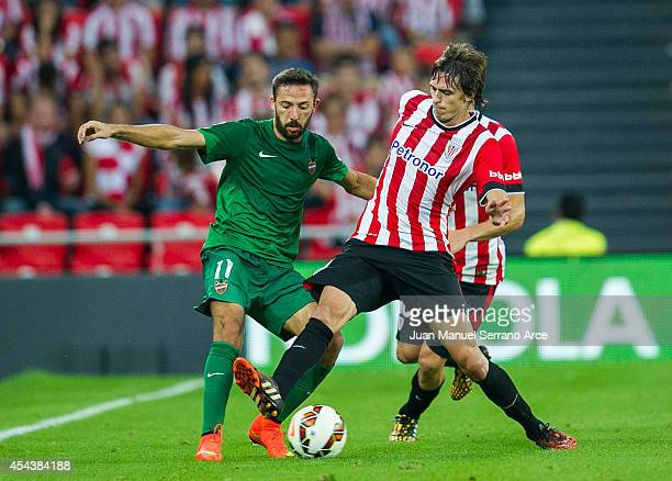 Ander Iturraspe of Athletic Club Bilbao duels for the ball with Jose Luis Morales of Levante UD the La Liga match between Athletic Club and Levante...