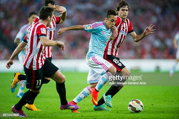 Ander Iturraspe of Athletic Club duels for the ball with Fabian Orellana of Celta de Vigo during the La Liga match between Athletic Club and Celta de...