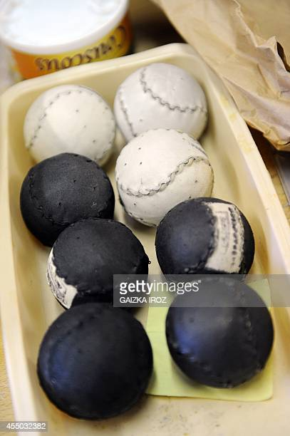 Ander Ugarte works on pelotas made with leather and used to play the Basque pelota game in his workshop in Ascain southern France on September 3 2014...