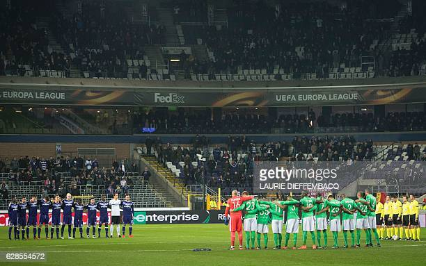 RSC Anderlecht football team and AS SaintEtienne football team stand up during a minute of silence to pay a tribute to plane crash in Colombia where...