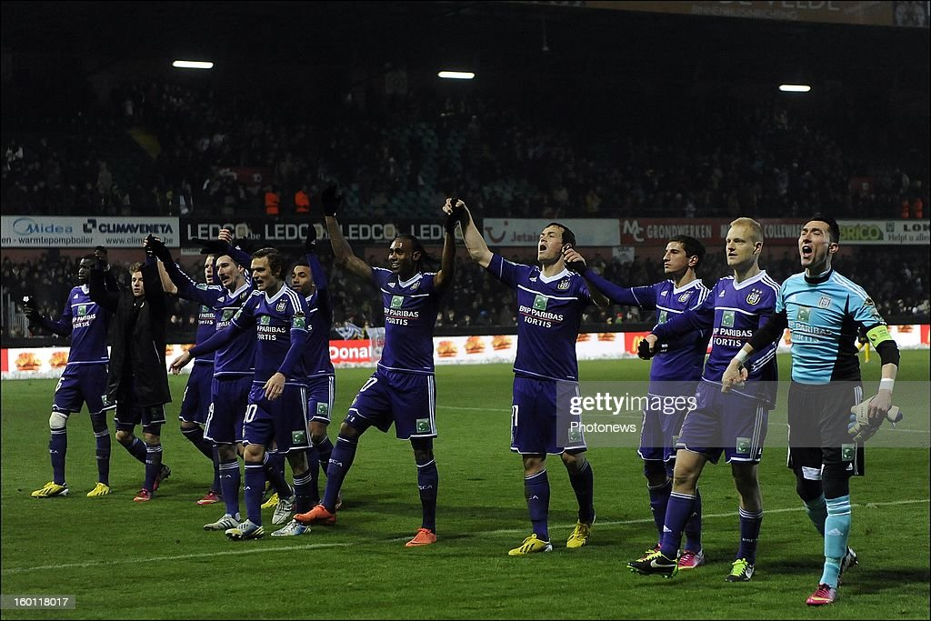 Anderlecht players celebrate during the Jupiler League match between Sporting Lokeren and Sporting Anderlecht on January 26, 2013 in Lokeren, Belgium.