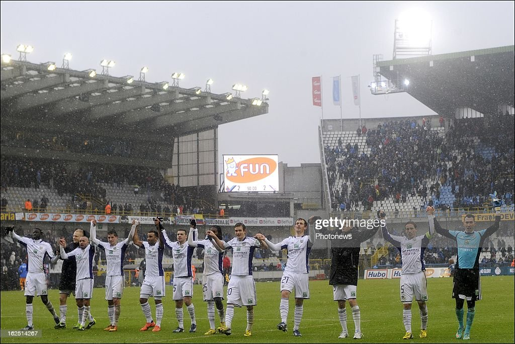 Anderlecht players celebrate during the Jupiler League match between Club Brugge and RSC Anderlecht on February 24, 2013 in the Jan Breydel Stadium in Brugge, Belgium.