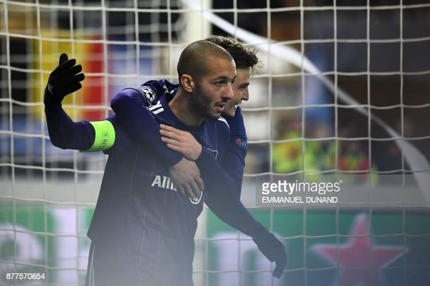 Anderlecht's Algerian midfielder Sofiane Hanni celebrates after scoringa goal during the UEFA Champions League Group B football match between...