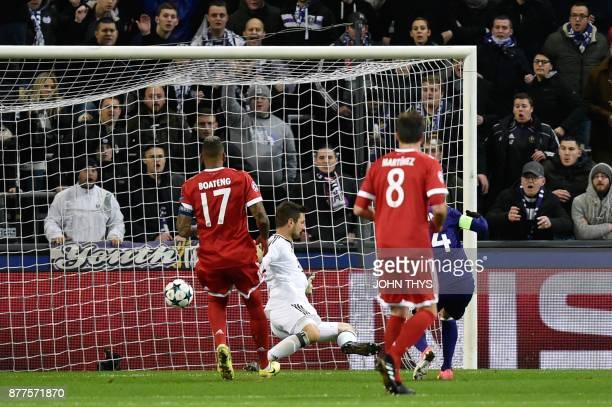 Anderlecht's Algerian midfielder Sofiane Hanni scores a goal past Bayern Munich's German goalkeeper Sven Ulreich during the UEFA Champions League...