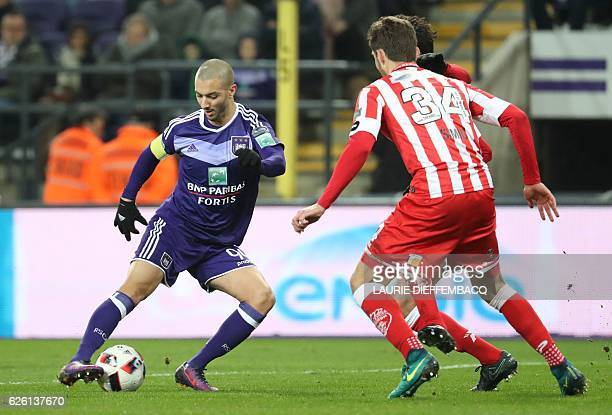 Anderlecht's Algerian midfielder Sofiane Hanni vies for the ball with Mouscron's Czech defender Stefan Simic during the Belgian soccer championship...