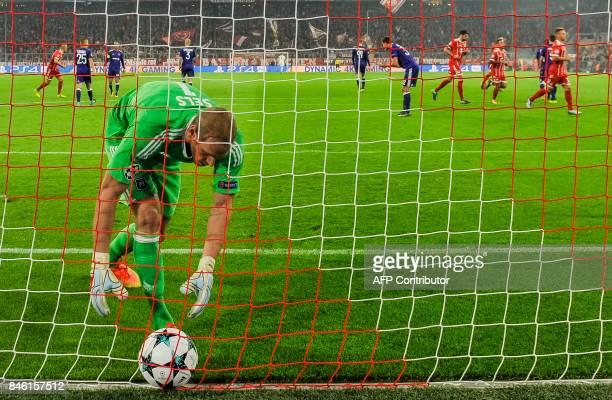 Anderlecht's Belgian goalkeeper Matz Sels picks up the ball after a penalty during the Champions League group B match between Bayern Munich and RSC...