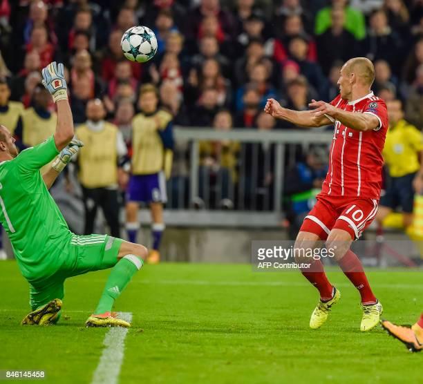 Anderlecht's Belgian goalkeeper Matz Sels safes a shot from Bayern Munich's Dutch midfielder Arjen Robben during the Champions League group B match...