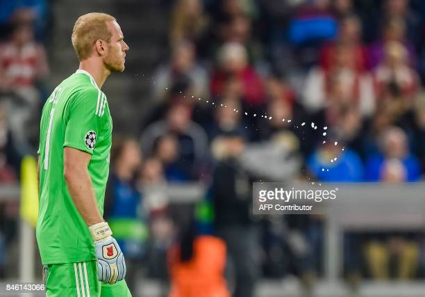 Anderlecht's Belgian goalkeeper Matz Sels spits water during the Champions League group B match between Bayern Munich and RSC Anderlecht in Munich...