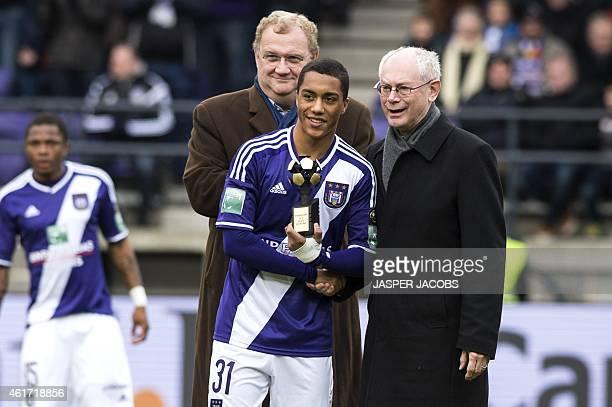 Anderlecht's Belgian midfielder Youri Tielemans holding his 2014 best new comer award poses with former European Council President Herman Van Rompuy...