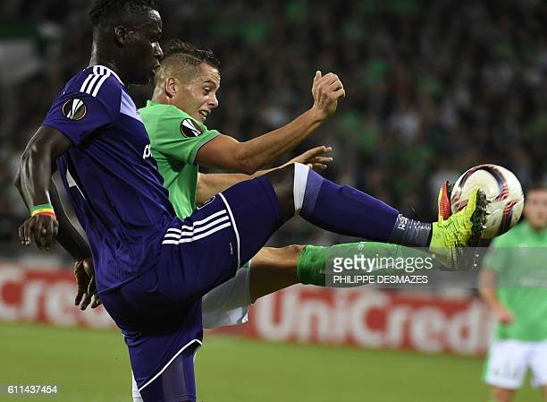 Anderlecht's Belgium defender Kara Mbodj vies with SaintEtienne's French forward Romain Hamouma during the Europa League football match AS...