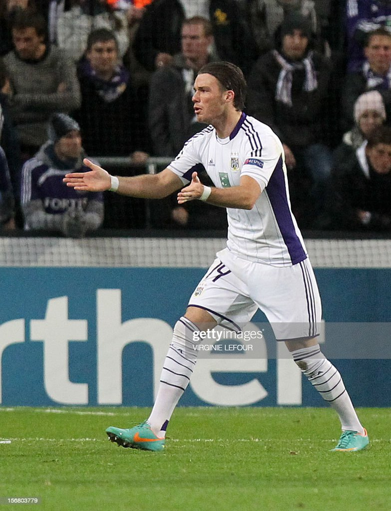 Anderlecht's Bram Nuytinck reacts after receiving a red card during an UEFA Champions League group C football match between Anderlecht and AC Milan on November 21, 2012 in Brussels. Belgium Out