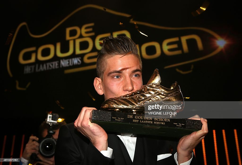 Anderlecht's <a gi-track='captionPersonalityLinkClicked' href=/galleries/search?phrase=Dennis+Praet&family=editorial&specificpeople=8569027 ng-click='$event.stopPropagation()'>Dennis Praet</a> kisses his trophy after winning the 61th edition of the 'Golden Shoe' award ceremony, on January 14, 2015, in Lint. The Golden Shoe is an award for the best soccer player of the Belgian Jupiler Pro League championship during the calender year 2014.