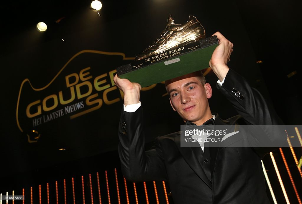 Anderlecht's <a gi-track='captionPersonalityLinkClicked' href=/galleries/search?phrase=Dennis+Praet&family=editorial&specificpeople=8569027 ng-click='$event.stopPropagation()'>Dennis Praet</a> poses with his trophy after winning the 61th edition of the 'Golden Shoe' award ceremony, on January 14, 2015, in Lint. The Golden Shoe is an award for the best soccer player of the Belgian Jupiler Pro League championship during the calender year 2014.