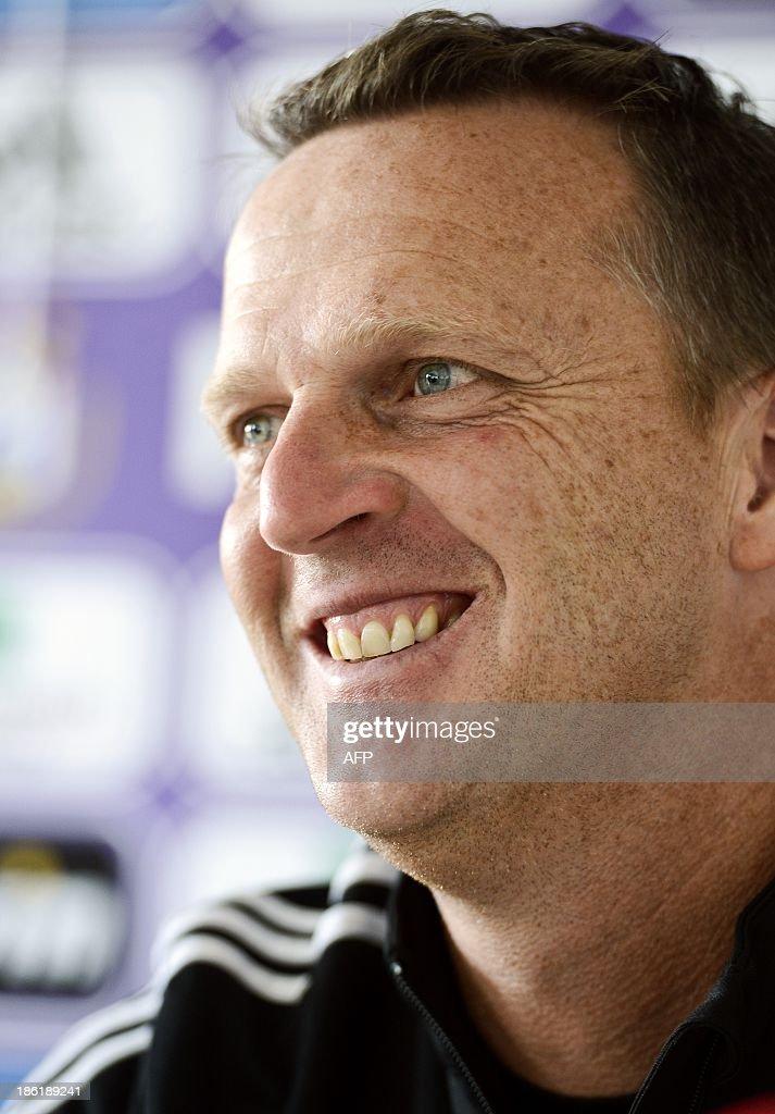 Anderlecht's Dutch coach John van den Brom smiles during a press conference in Brussels on October 29, 2013.