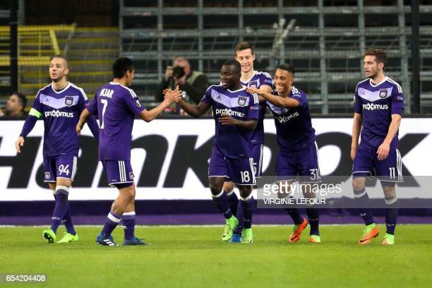 Anderlecht's Frank Acheampong celebrates with teammates after scoring a goal during the Europa League football match between RSC Anderlecht and Apoel...