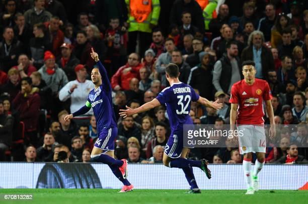 Anderlecht's French born Algerian midfielder Sofiane Hanni celebrates scoring his opening goal with team mate Leander Dendoncker during the UEFA...