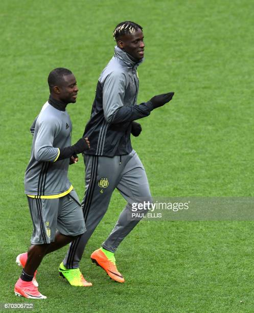 Anderlecht's Ghana forward Frank Acheampong and Senegal defender Kara Mbodji participate in a training session at Old Trafford in Manchester north...