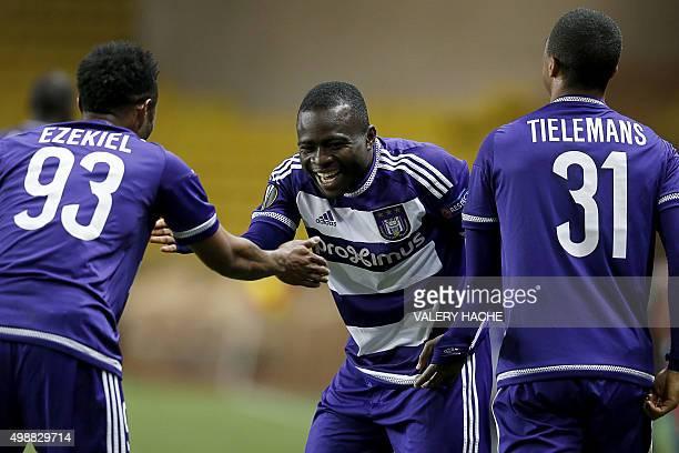 Anderlecht's Ghanaian midfielder Frank Acheampong celebrates with Anderlecht's Nigerian forward Imoh Ezekiel adn Anderlecht's Belgian midfielder...