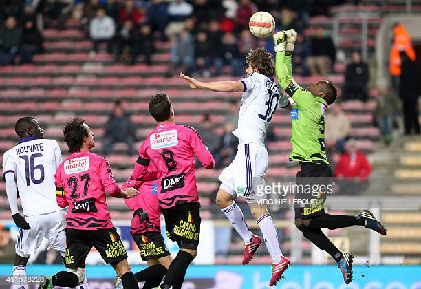 RSC Anderlecht's Guillaume Gillet and Charleroi's goalkeeper Parfait Mandanda fight for the ball during the Jupiler Pro League match in Charleroi on...