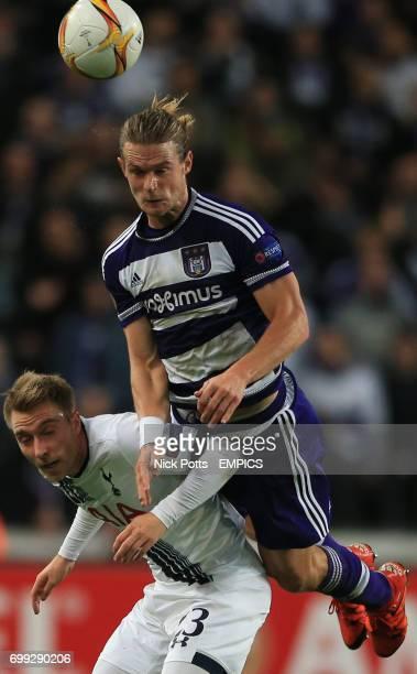 Anderlecht's Guillaume Gillet wins header beating Tottenham Hotspur's Christian Eriksen
