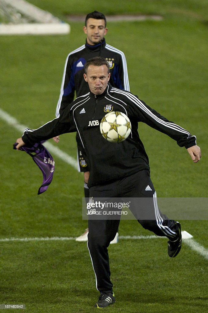 Anderlecht's head coach John van den Brom controls the ball during a training session at Ciudad de Malaga stadium in Malaga on December 3, 2012, on the eve of the UEFA Champions League Group C football match Malaga CF vs RSC Anderlecht.