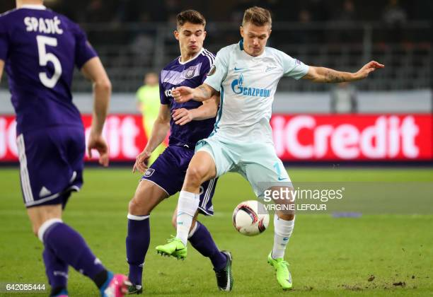 Anderlecht's Leander Dendoncker and Zenit's midfielder's Oleg Shatov fight for the ball during the UEFA Europa League football match between...